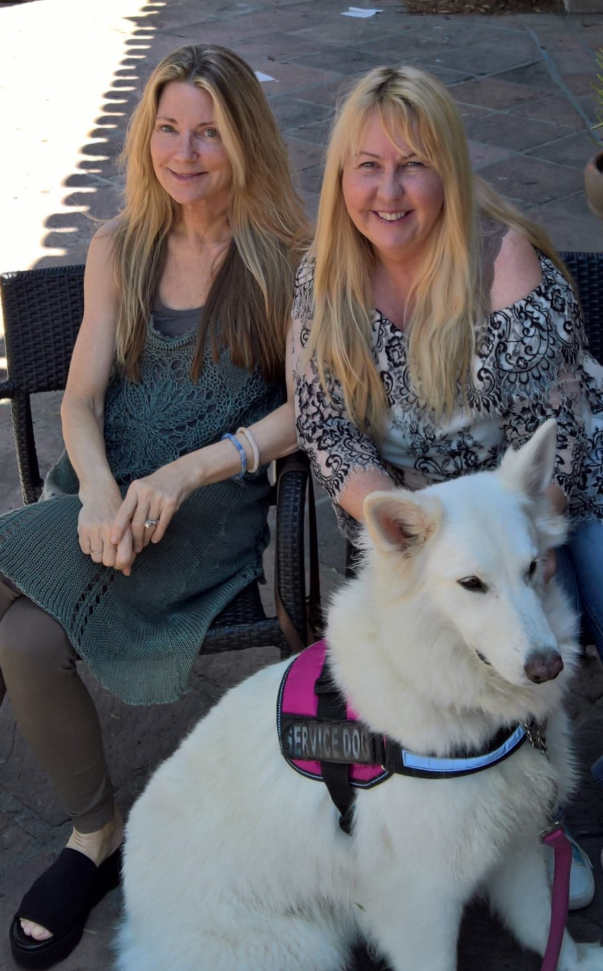 A High Honor ( photo: at right, Georgienne Bradley of Sea Save, with the author. White shepherd:Denali)